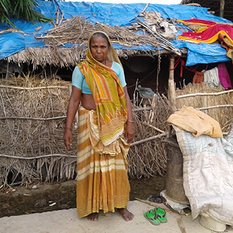 Kushmatia standing outside her home