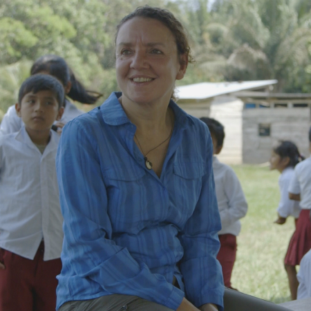 Eleri Davies sitting with children at a school in Bolivia