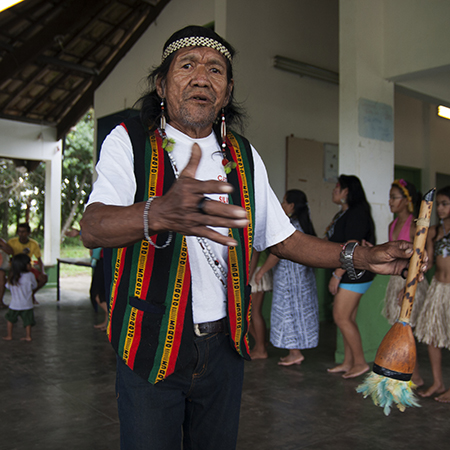 A religious leader of Tupi-Guarani indigenous community in Sao Paulo performs a cultural dance
