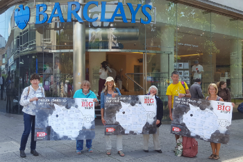 A group of campaigners hold Big Shift posters outside Barclays in Plymouth