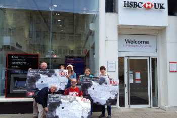 Campaigners hold Big Shift posters outside of HSBC in Plymouth
