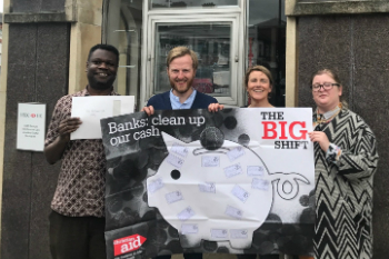 Four campaigners hold Big Shift posters outside HSBC in Wolverhampton