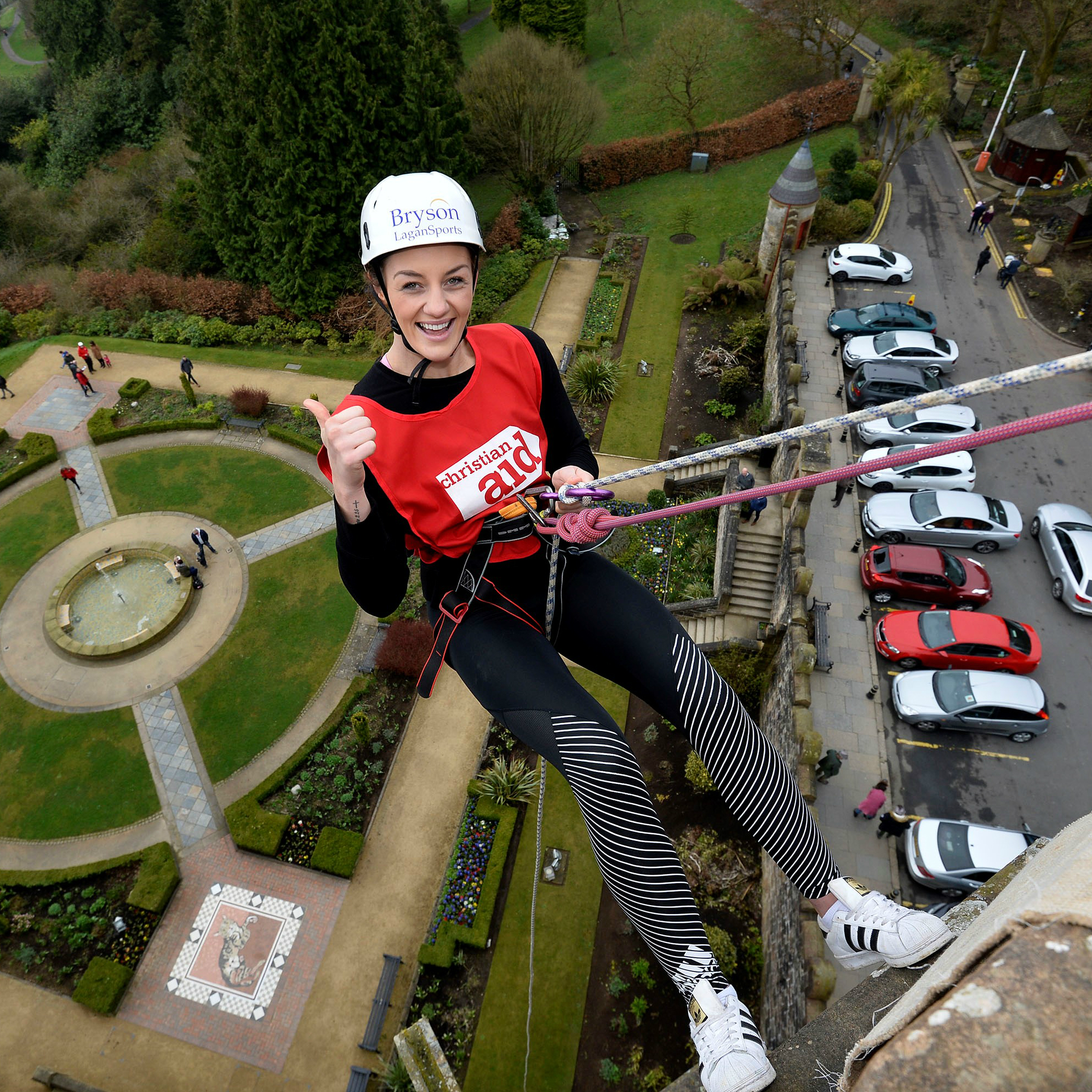 MMA world champion Leah McCourt abseils down Belfast Castle for Christian Aid Week