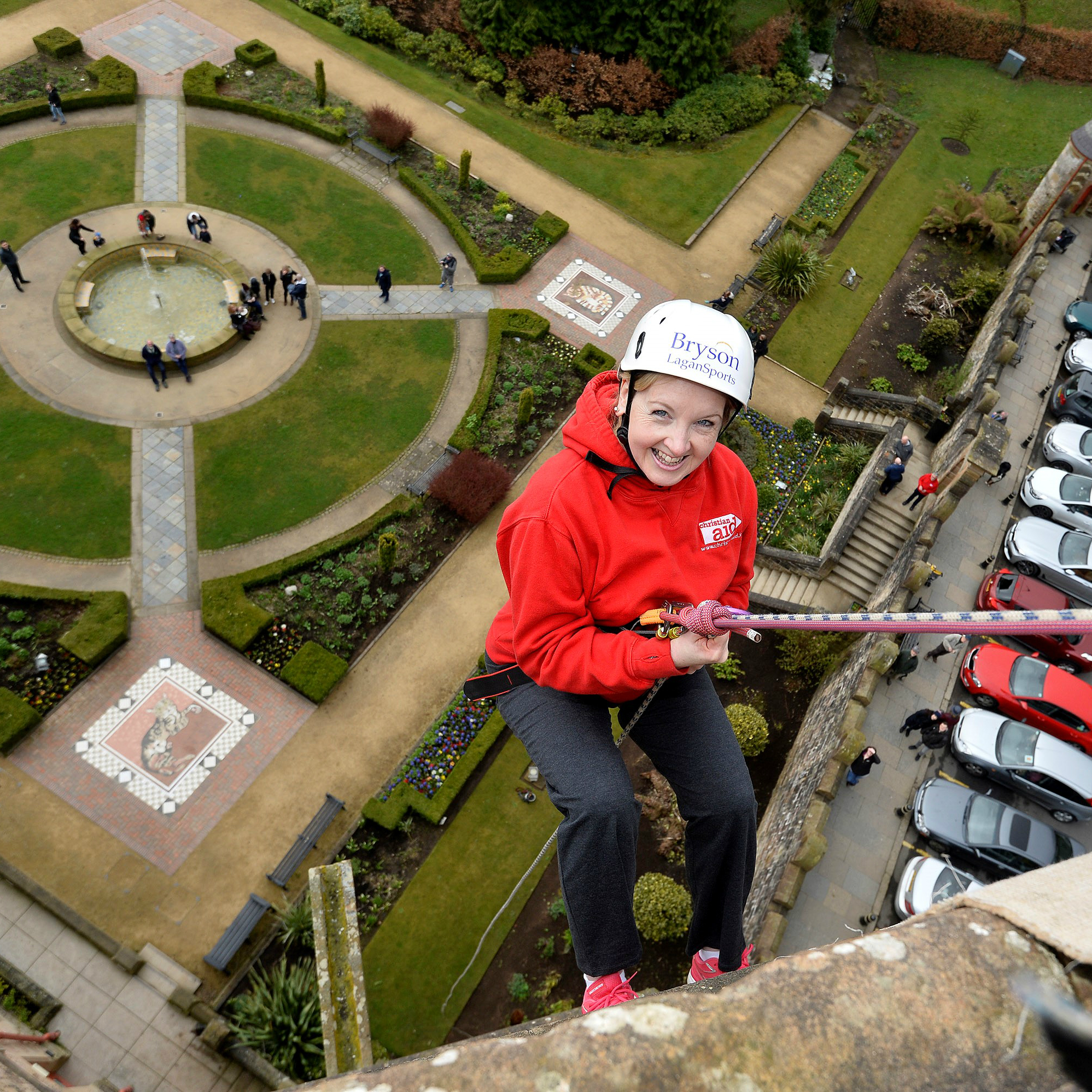 Christian Aid Ireland's Chief Executive Rosamond Bennett abseils down Belfast Castle for Christian Aid Week
