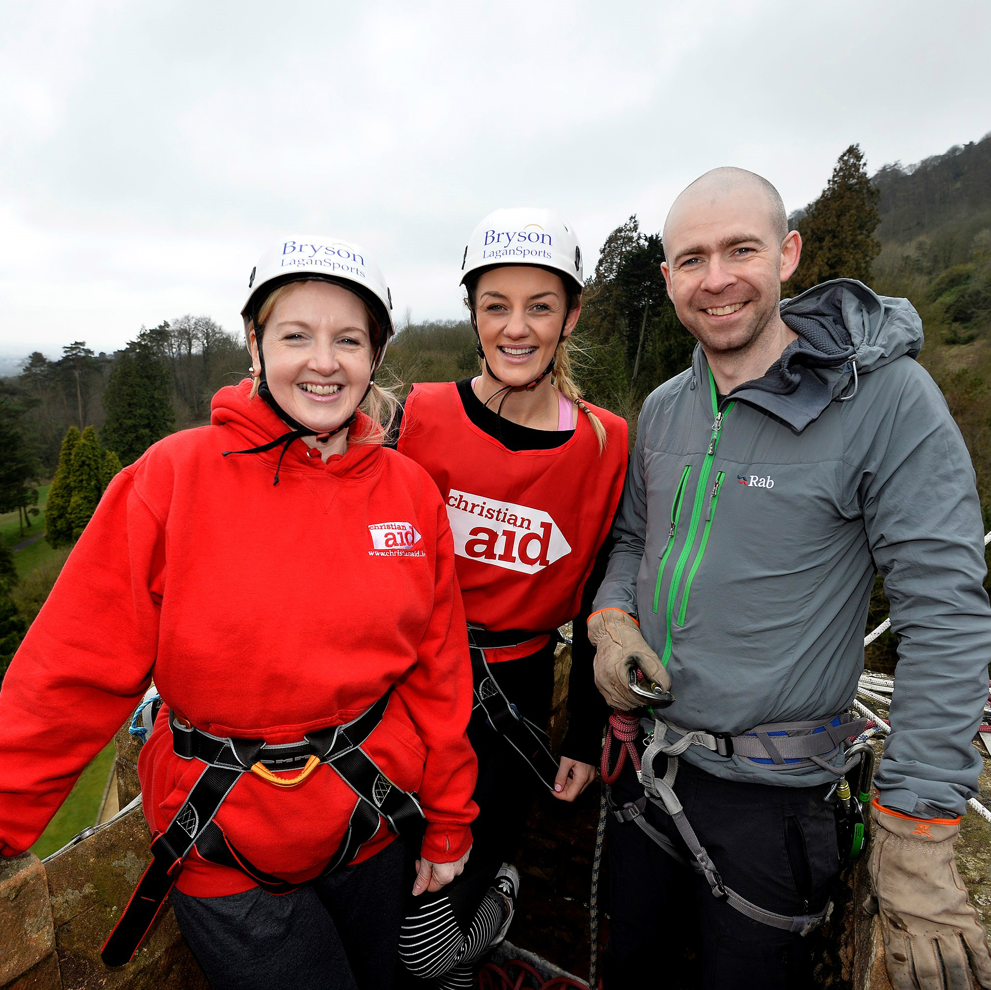 Christian Aid Chief Executive Rosamond Bennett and MMA world champion Leah McCourt get prepared for their abseil challenge