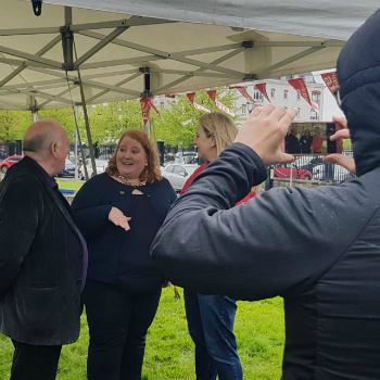 Councillor's Naomi Long and Fra McCann speak with Christian Aid Ireland's Chief Executive Rosamond Bennett at the Solidarity Sleep-Out