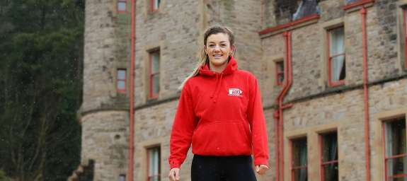 MMA world champion Leah McCourt prepares to abseil Belfast Castle for Christian Aid