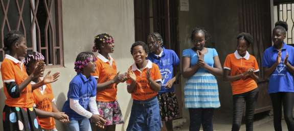 Girls enjoying a music and movement activity at The Girls Building Bridges project in Angola