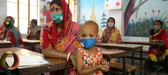 Child wears protective face mask to prevent spread of Coronavirus