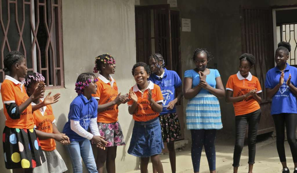 Girls in Angola enjoying a music and movement activity at the Girls Building Bridges project