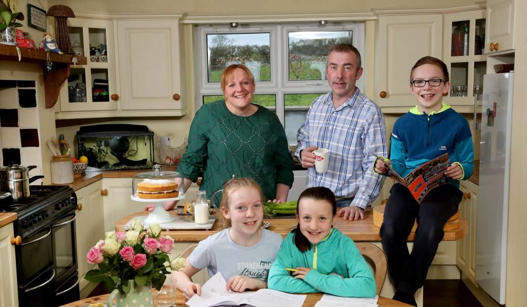 Susie Hamilton pictured with her family in the family home in Saintfield County Down