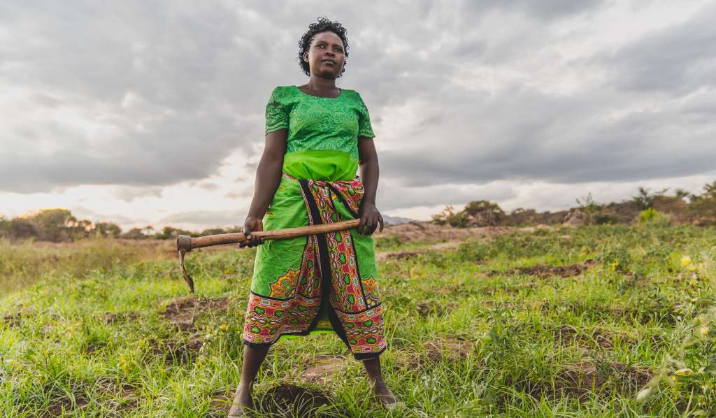 Faith Muvili standing a field in Makueni County, Kenya