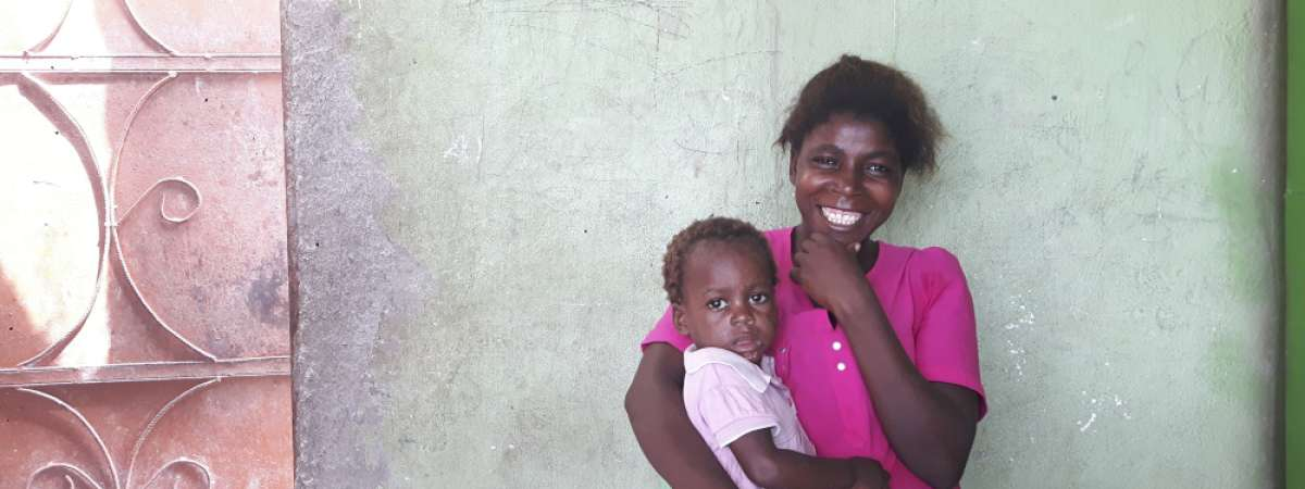 Avelina Nangulande, 28 from Angola, holds her two-year-old daughter Dominga