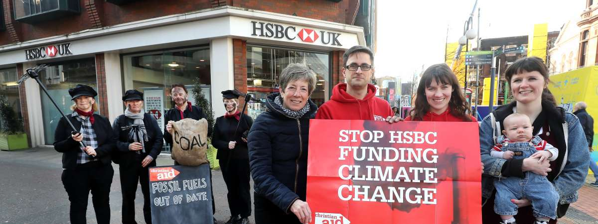Christian Aid activists protest in Belfast, urging HSBC bank to stop funding climate change