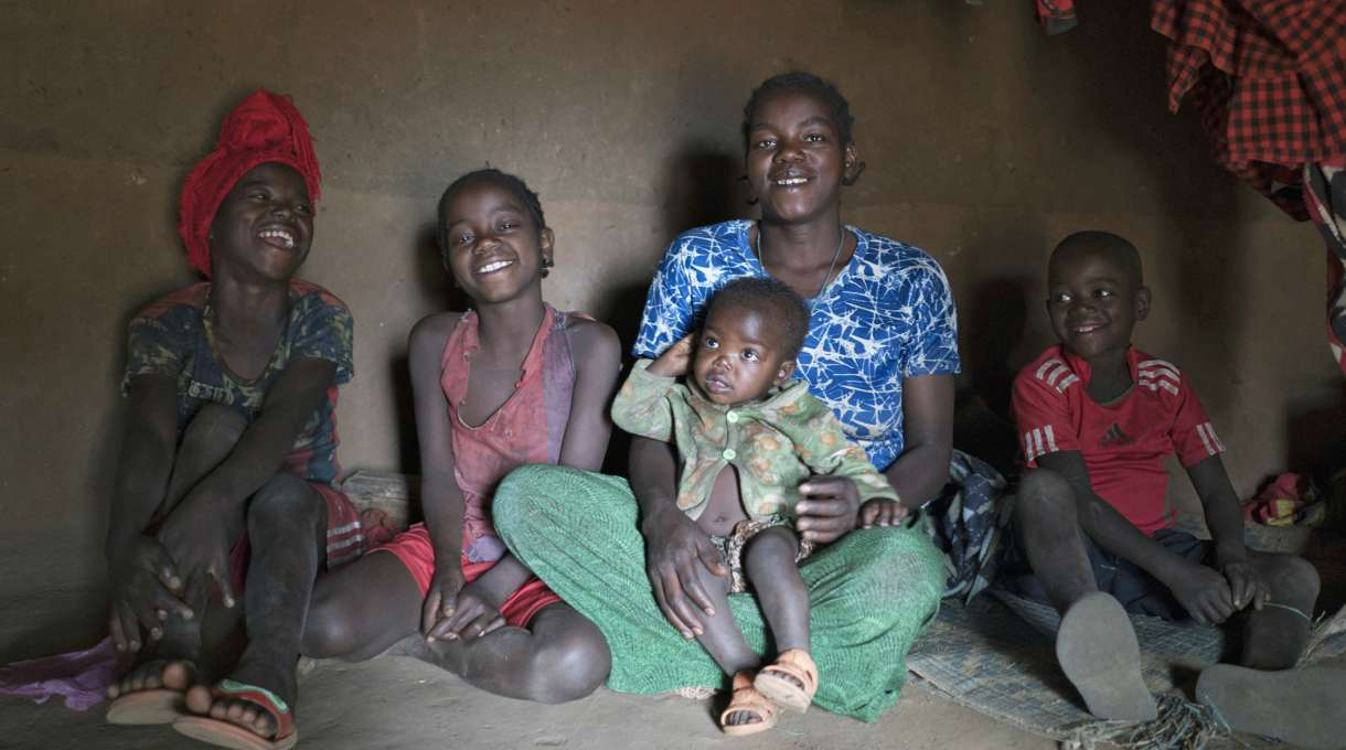 Aster Argo and her family inside their home in Ethiopia