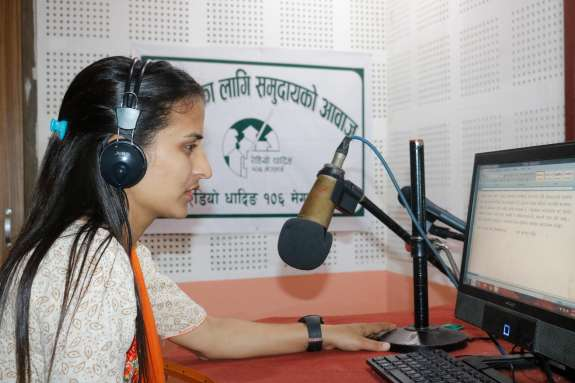 Woman broadcasting to radio in Nepal