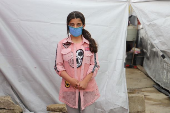 12-year-old Syrian refugee Yasmine outside her tented home in the Bekaa valley, Lebanon.