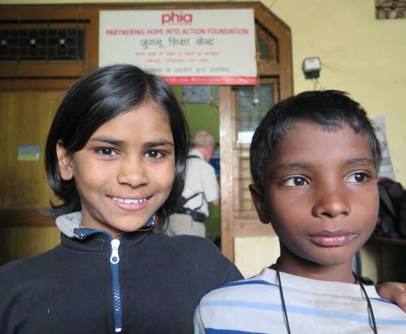 Charisma, 10, and her friend at the Bridge school run by Christian Aid partner, Phia, in Bhowpur, India.