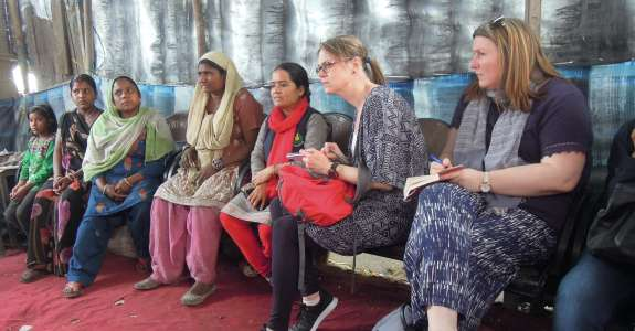 Parents of children attending the Bridge School meet with a group from Christian Aid Ireland in Bhowpur, India, 2017.