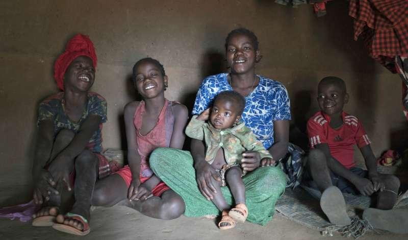 aster Argo and her children inside their home in Ethiopia