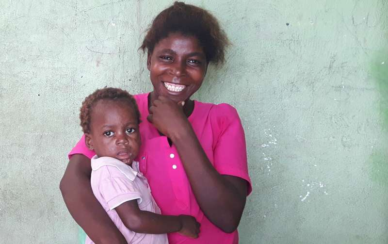 Avelina and Dominga from Angola who live in 16 June community
