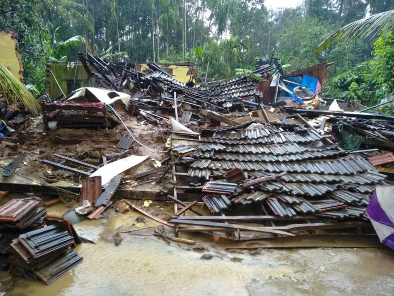A house lies destroyed during the floods in Kerala
