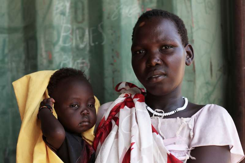 Mother and her child embrace in South Sudan