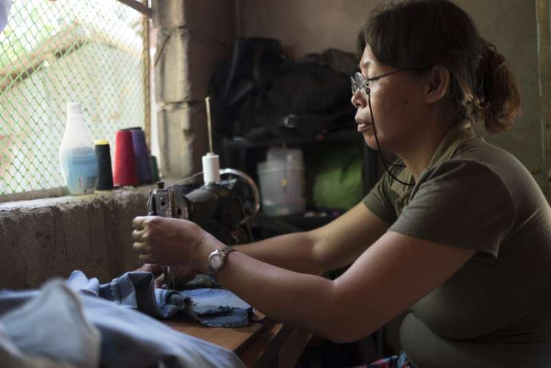 Mary Ann sewing with solar light