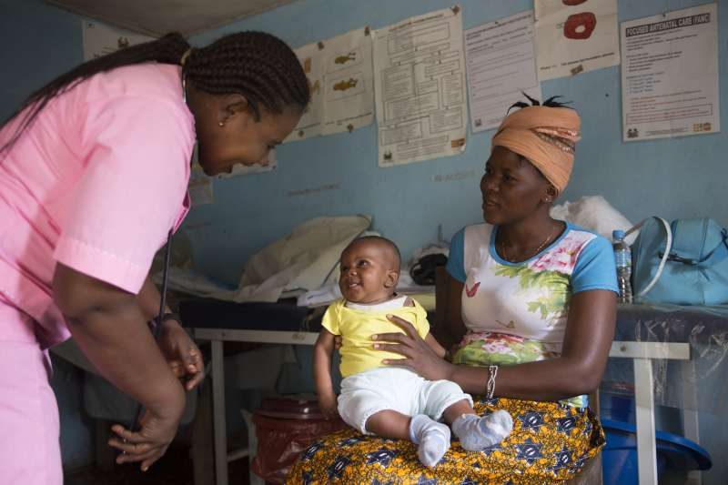Nurse Judith gives Tenneh's baby a check-up in the temporary health clinic.