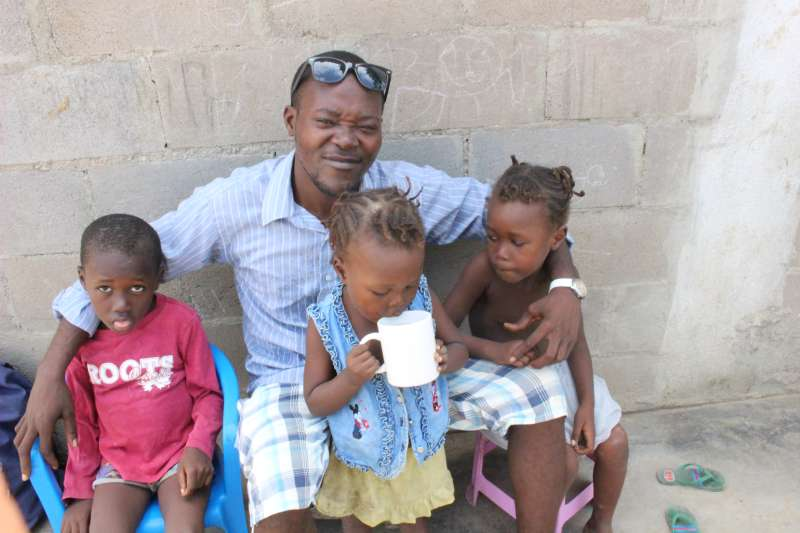 Evaristo with his three children Emilo, Maria and Bernarda in Angola