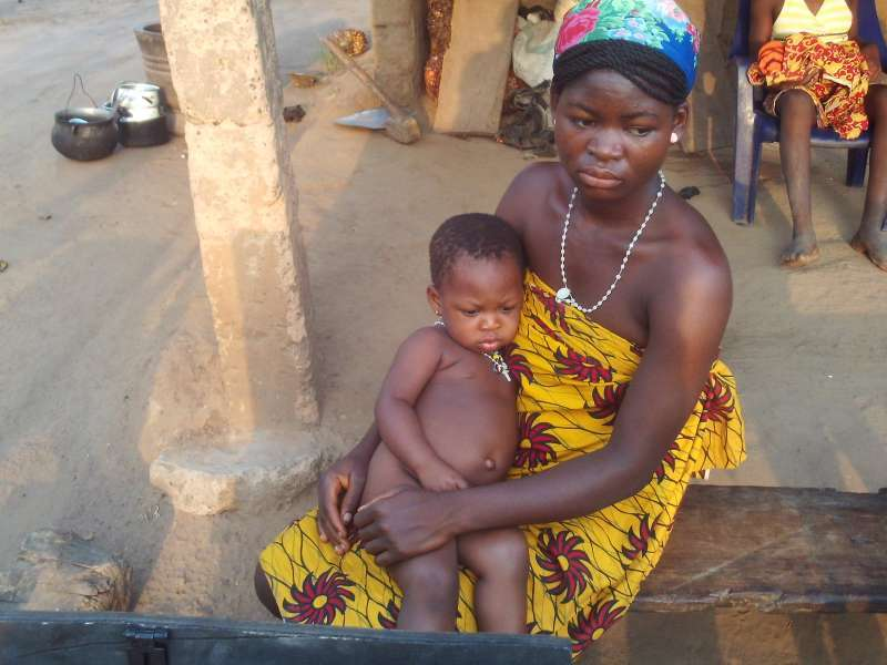A mother and child, treated by a community health volunteer in Nigeria