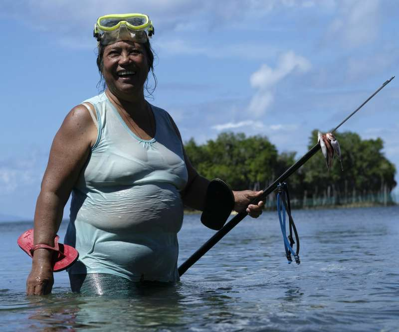 59-year-old fisherwoman and member of the women's group Virginia catching fish with her spear