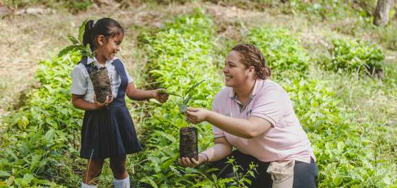 Lilliam Perez 25, Soppexcca technician with Ariana Blandon 5 in a school vegetable garden in Santa Rosa, around two hours from Jinotega in Nicaragua.