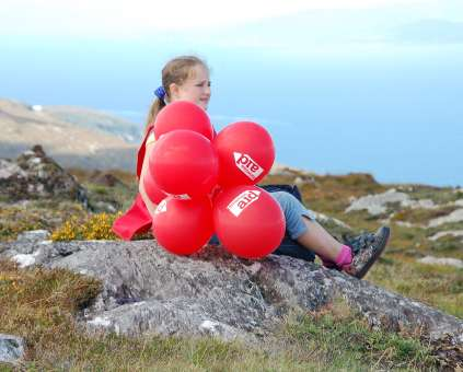 Young girl takes a rest on the Sheep's Head Hike