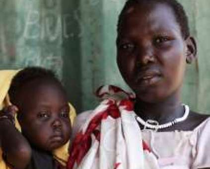 Mother holds malnourished daughter in South Sudan