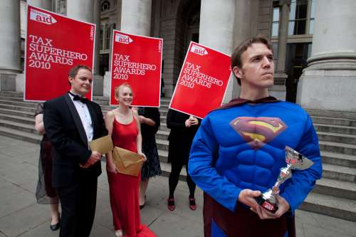 Christian Aid campaigners hold the Tax Superhero Awards in 2010 to highlight the damage caused by tax dodging to companies at the annual tax awards in London.