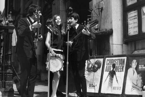 Pop group on the steps of St Martins in the Fields during Christian Aid Week, 1966