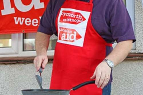 Peredur Owen Griffiths cooking at a Christian Aid fundraising event