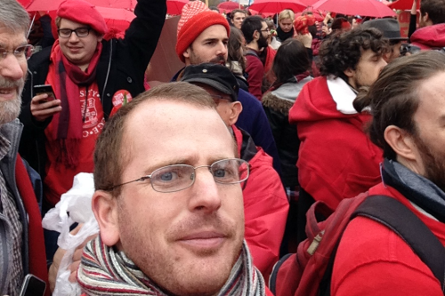 Michael Briggs attends a climate rally in Paris
