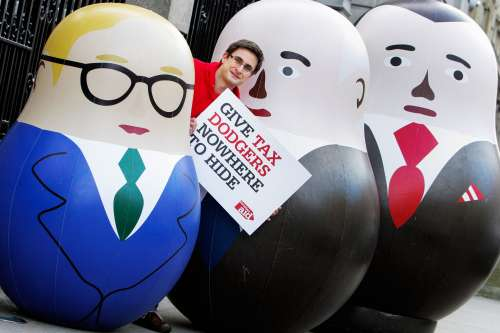 Dave Thomas poses outside Leinster House in Dublin with three Russian dolls
