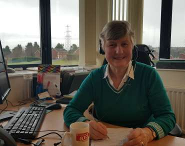 Suzanne Shepherd, a Christian Aid office volunteer Belfast, sits at desk