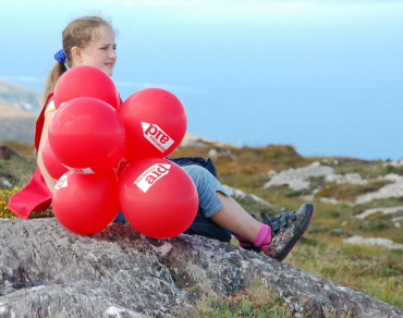 Girl with Christian Aid balloons