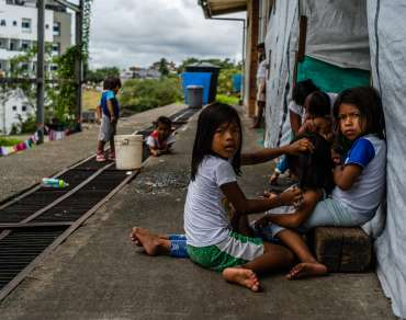 A group of children sit outside the shelter for displaced indigenous people in Buenaventura, Colombia.