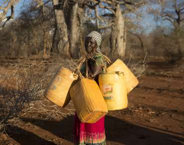 Rose from Kenya carrying water bottles