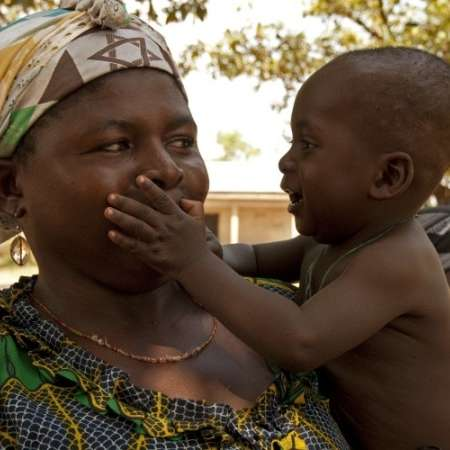 A woman holding a child in Ghana
