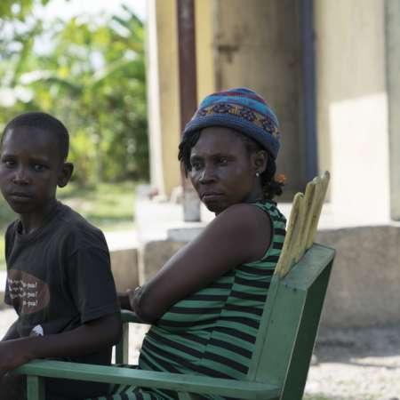 Vilia, a lady in Haiti, with her child
