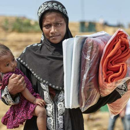 Rohingya lady carrying her son in Bangladesh