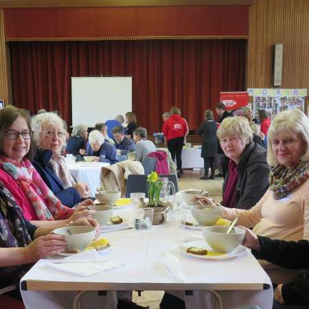 Ladies enjoying lunch at a Christian Aid Lunch event.