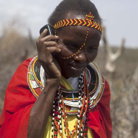 Woman in Ethiopia with mobile telephone to help her business