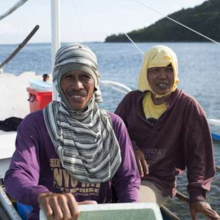 Lope and Eva on their fishing boat in the Philippines
